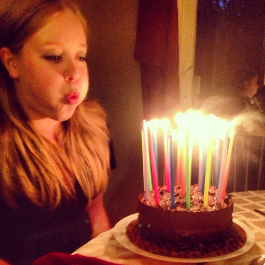 Blowing out candles - Julie101.com